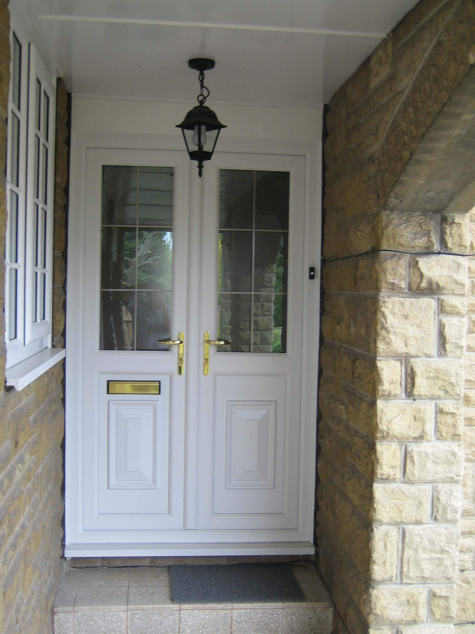 white front door with gold hardware